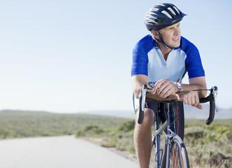 Man in helmet sitting on bicycle