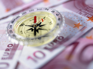 Close up of compass on 10 euro notes
