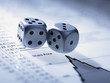 Silver dice on list of share prices