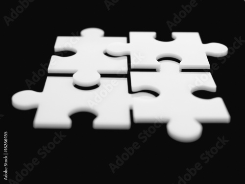 Four interlocking puzzle pieces