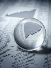 """""""Crystal ball, ascending line graph and share prices"""""""
