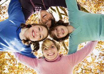 Girls hugging in circle
