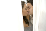Couple kissing Amongst Drapes