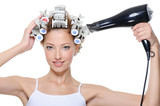 woman with hair-curles and hairdryer doing hairstyle poster
