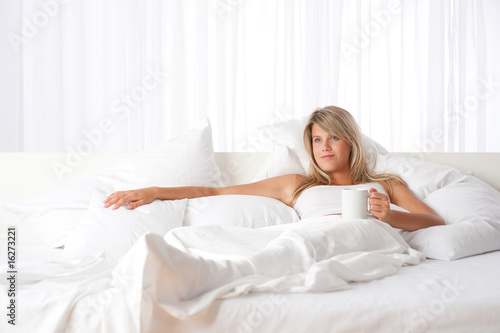 Blond woman holding cup of coffee