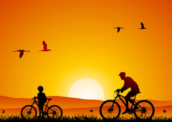 Mountain bike at sunset with child