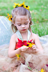 A little woodland fairy gathering flowers.