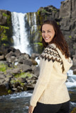 Beautiful and Happy Scandinavian Woman In Front Of A Waterfall poster
