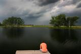 Solitude man at the lake poster