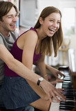 Couple playing duet on piano
