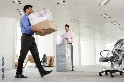 Business people moving into new office