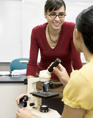 Teacher talking to student in laboratory