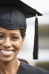 Smiling woman in graduation cap and gown