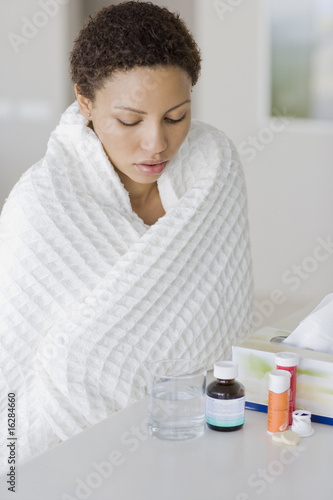Sick woman looking at medication