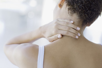 Woman rubbing sore neck