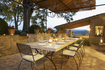 """Elegant table set on patio, Umbria, Italy"""