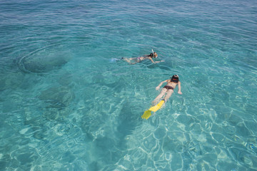 Girls snorkeling in ocean