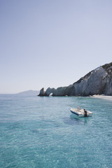 """Motorboat mooring off beach, Lalaria Beach, Skiathos, Greece"""
