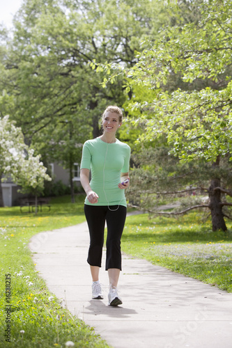 Happy woman walking with MP3 player