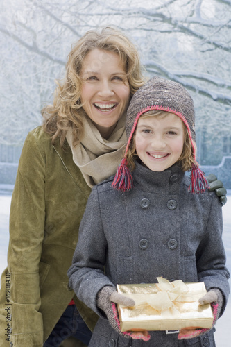 Mother and daughter holding Christmas gift