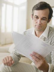 Man examining bills