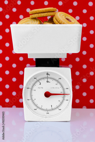 kitchen scales with cookies weight loss diet concept