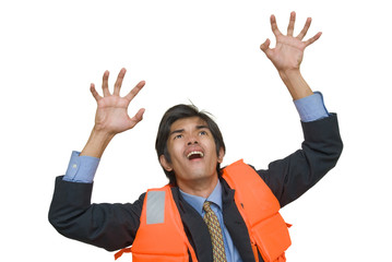 Desperate businessman in life jacket
