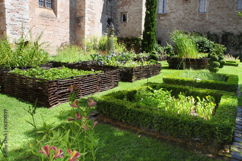 Leinwanddruck Bild Medieval herb- and flower garden