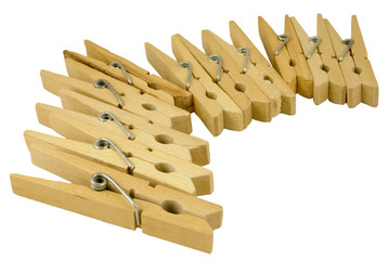curve of wooden clothes pegs isolated on white background