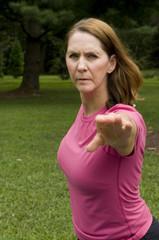3/4 shot of woman doing yoga
