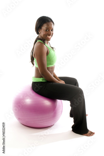 young pretty hispanic african american woman exercising with fit