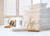 Fluffy white towels on table poster