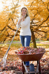 Woman doing  yard work in autumn