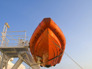 Low angle view of red lifeboat