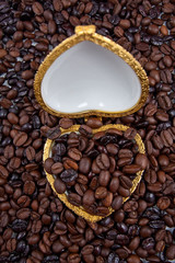 coffee beans in heart shaped golden box