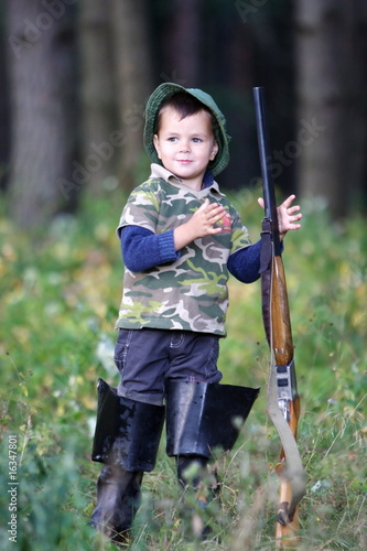 Boy hunting with gun.