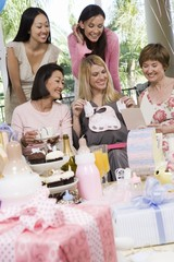 Pregnant Woman with friends at a Baby Shower