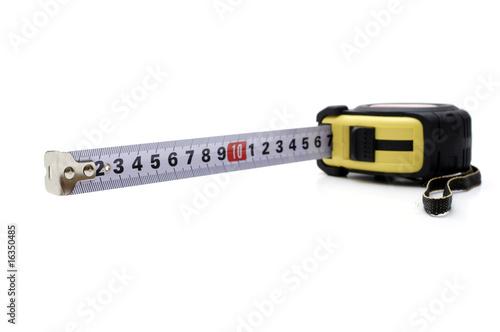Leinwandbild Motiv Opened tape measure on white isolated background