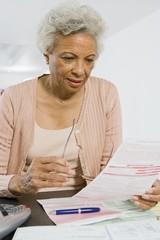 Senior Woman Studying Home Finances