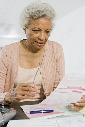Senior Woman Studying Home Finances