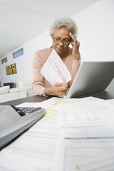 Senior Woman Worrying About Home Finances