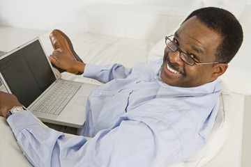Cheerful Senior Man Using Laptop