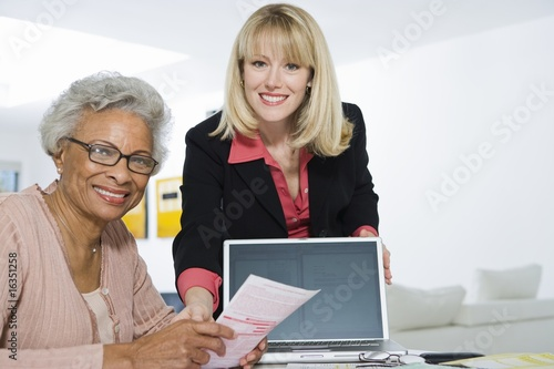 Financial Advisor Assisting Senior Woman
