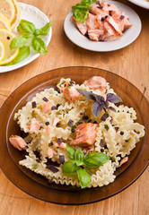 one serving of pasta mafalde with salmon