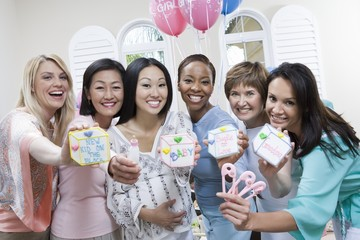 Pregnant Asian Woman with friends at a Baby Shower