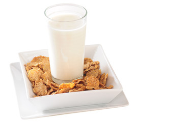Glass of milk on portion of cereal