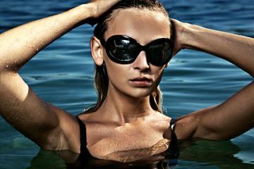 Beautiful young woman at a swimming pool