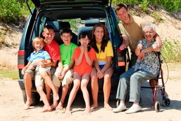 Happy family by car