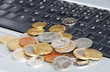 Many coins in one place on laptop keyboard