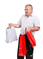 Elderly white man with bags for shopping